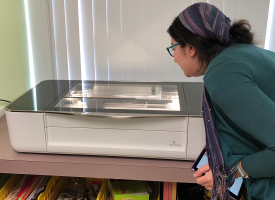 Teacher watches Glowforge Printer