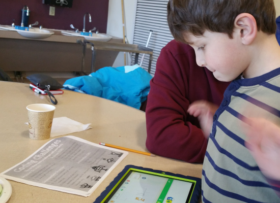 Students uses iPad to Code with Scratch Jr.